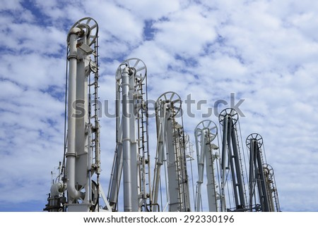 Deep sea port loading arm oil refinery. - stock photo