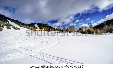 Deep snow pack at the ski area at the village of Sun Peaks in the Shuswap Highlands of British Columbia, Canada - stock photo