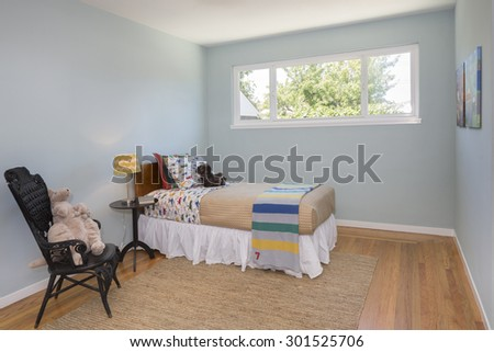 Deep Turquoise Blue bedroom teenager with matching decoration and black wooden chair. - stock photo