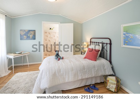 Deep Turquoise Blue Children bedroom / kids room / teen room with closet and colorful decoration. - stock photo