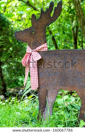 Deer made of iron with a ribbon