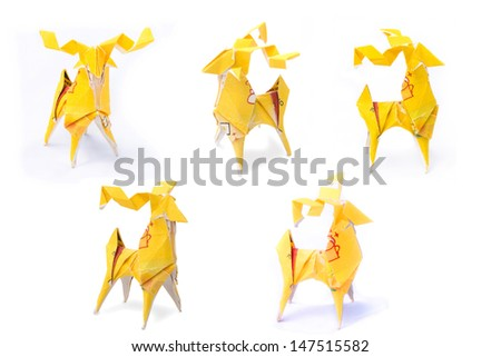 deer origami fold from yellow tea bag. - stock photo