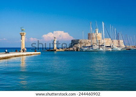 Deer statues and the Fort of St Nicholas at the entrance to Mandraki Harbour Rhodes Greece Europe - stock photo