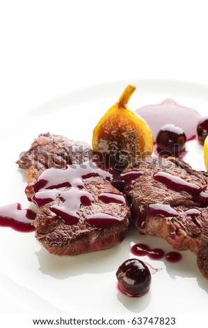 Deer steak with cranberries sauce - stock photo