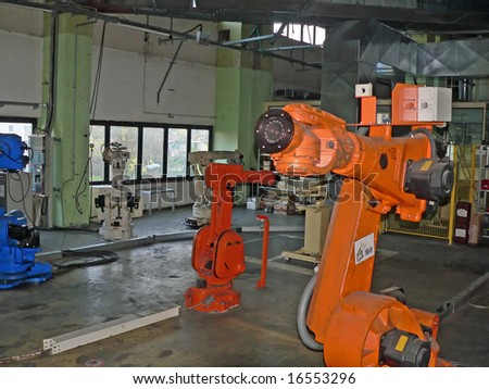 Defective and dead robots waiting for maintenance. - stock photo