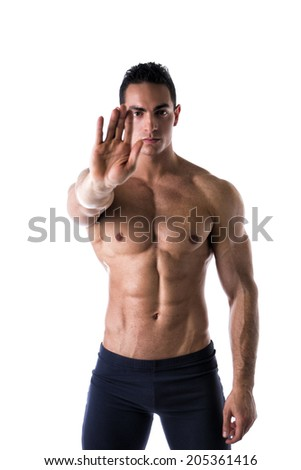 Defiant stern man making a Halt or Stop gesture holding his hand extended to the camera denying access, calling for a halt or finish, a stop, or indicating he has had enough and to go away - stock photo