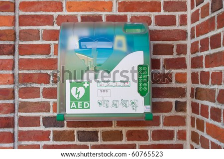 defibrillator hanging outside on a wall - stock photo