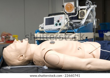 Defibrillator on a dummy for practice - stock photo