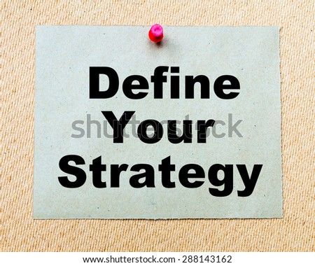Define Your Strategy  written on paper note pinned with red thumbtack on wooden board. Business conceptual Image - stock photo
