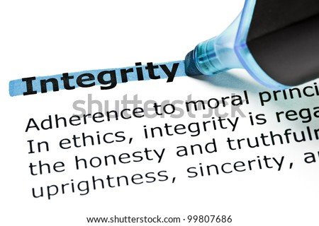 Definition of the word Integrity highlighted in blue with felt tip pen. - stock photo