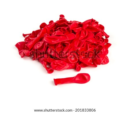 deflated red air ballons isolated on white - stock photo