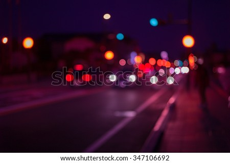 Defocus and blur image of city at night, Blur traffic road with bokeh light abstract background. Retro pink light style - stock photo