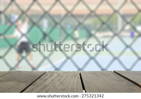 Defocus and blur image of terrace wood and tennis court with tennis ball for background usage - stock photo