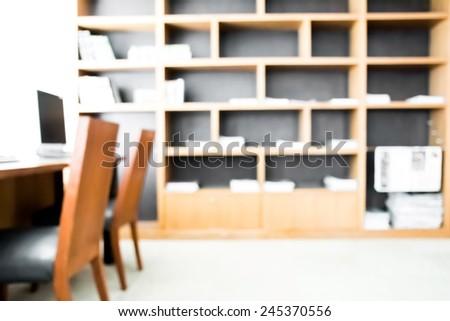 Defocus blur background of library book shelf. - stock photo
