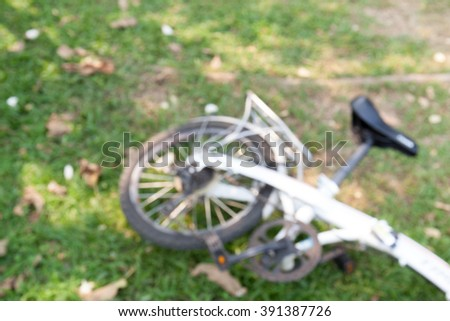 defocus of the old bicycle on the lawn background