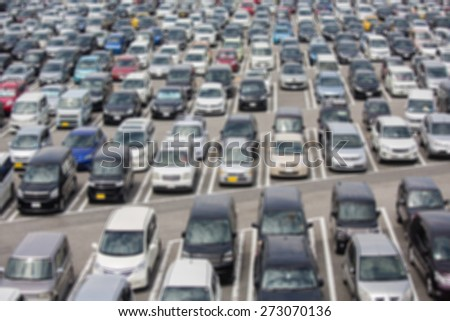 Defocus Outdoor car park with full parking - stock photo