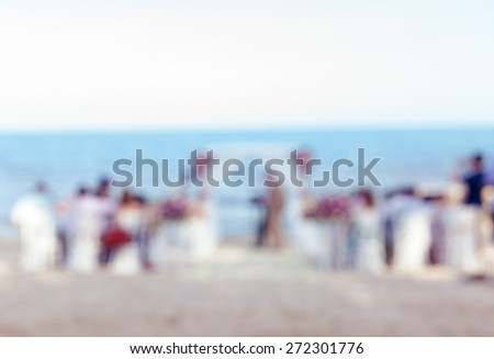 Defocus wedding ceremony venue on the beach , abstract blur background for card design, blurred wallpaper and illustration. - stock photo