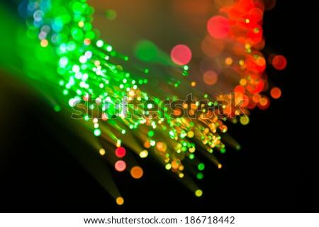 defocused abstract background of fiber optics - stock photo