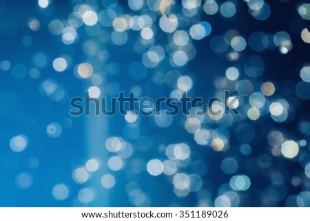 Defocused abstract blue christmas wallpaper. - stock photo
