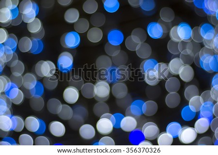 Defocused abstract blue white, black background - stock photo