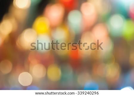 Defocused abstract bokeh lights christmas background, blur of bokeh circle light christmas festive backdrop concept. - stock photo
