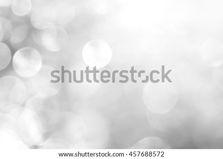 Defocused Abstract festive background with bokeh defocused lights and shadow. Christmas, holiday, party background. - stock photo