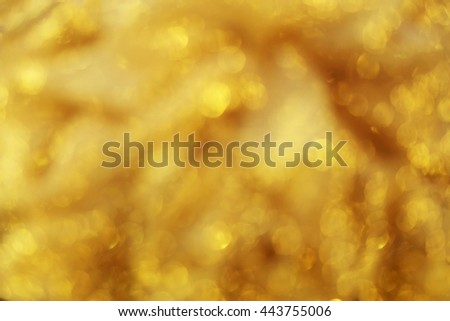 Defocused abstract golden light bokeh background. - stock photo
