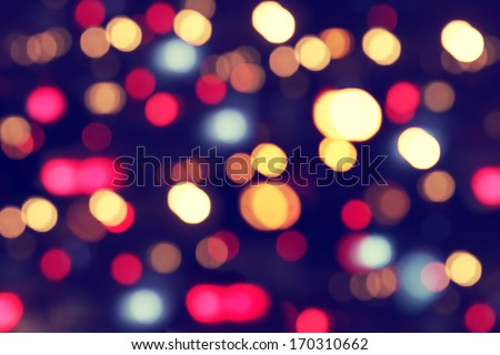 Defocused abstract multicolored bokeh lights background. - stock photo