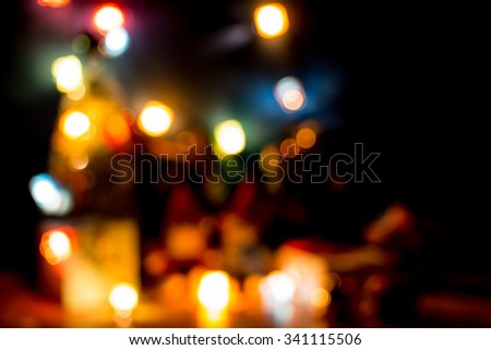 Defocused and blur Christmas light the Happiness night. Merry Christmas decoration with Lovely bear, a gift,  christmas tree, and ribbon are the Christmas ornament. - stock photo