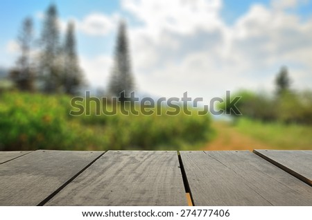 Defocused and blur image of terrace wood and beautiful garden park for background usage - stock photo