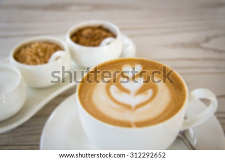 Defocused and blurred image for background of latte art with different kinds of sugar on wooden table - stock photo