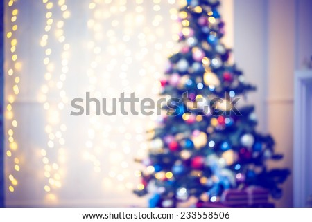 Defocused background Living room with christmas tree. Blue toned - stock photo