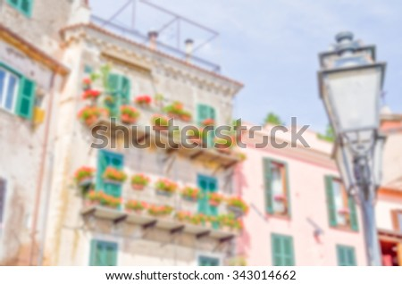 Defocused background of an ancient building in a small italian old town. Intentionally blurred post production for bokeh effect - stock photo