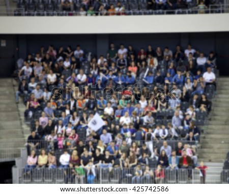 Defocused background of crowd of people in a basketball court
