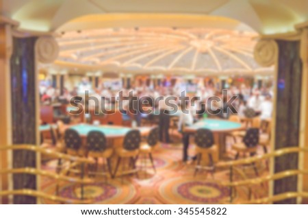 Defocused background of gambling casino tables. Intentionally blurred post production for bokeh effect - stock photo