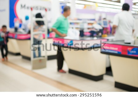 Defocused Background of People Paying Goods At Counter  - stock photo