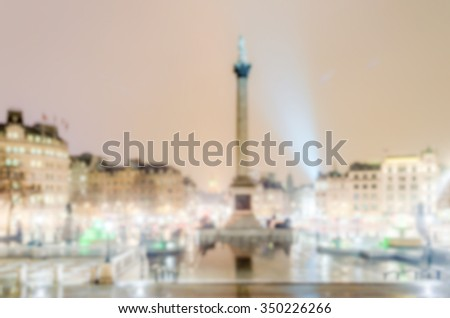 Defocused background of Trafalgar Square at night, London. Intentionally blurred post production for bokeh effect - stock photo