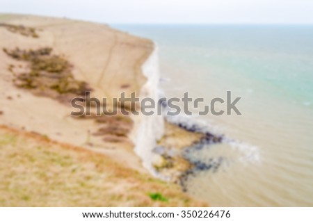Defocused background with the White Cliffs of Dover, UK. Intentionally blurred post production for bokeh effect - stock photo