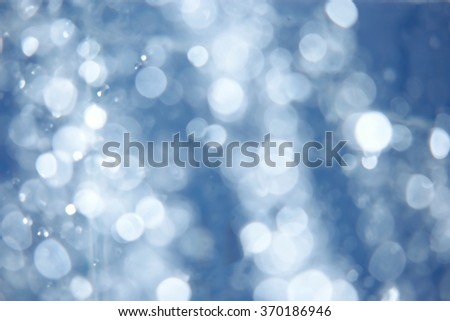 Defocused blue abstract spa background  water drops blurred in the air - stock photo