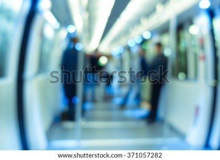 Defocused blur of people traveling in underground wagon - Metro transportation concept -  Defocused image - Cold blue filtered look - stock photo