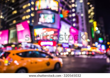 Defocused blur of Times Square in New York City with lights at night and taxi cab - stock photo