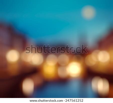 Defocused blurred background of European city Bruges (Brugge), Belgium in evening - stock photo