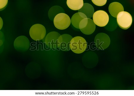 defocused blurry christmas green bokeh light for abstract background - stock photo