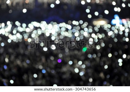 Defocused bokeh stage lights - stock photo