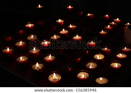 Defocused Candle background. Religion, memory, abstraction. - stock photo