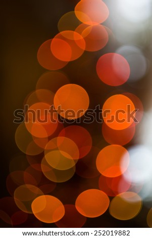 Defocused Christmas tree lights, colorful bokeh background. - stock photo