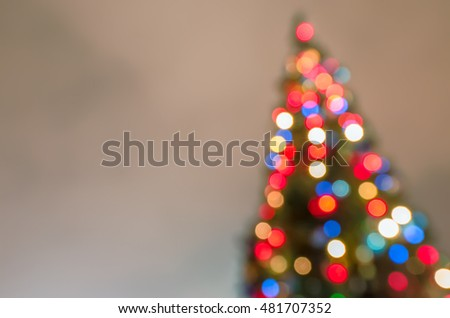 Defocused christmas tree silhouette with blurred lights