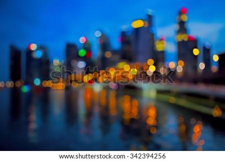 Defocused city lights, Singapore marina by night - stock photo