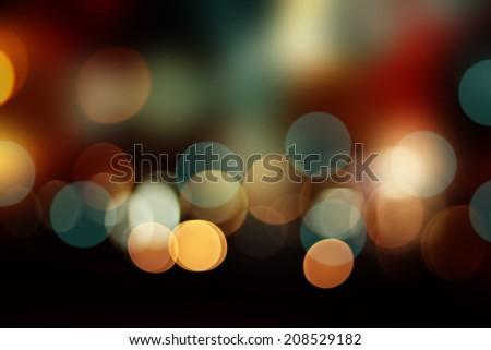 Defocused city night bokeh abstract background. - stock photo