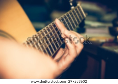 Defocused close-up playing guitar blurred for background. - stock photo
